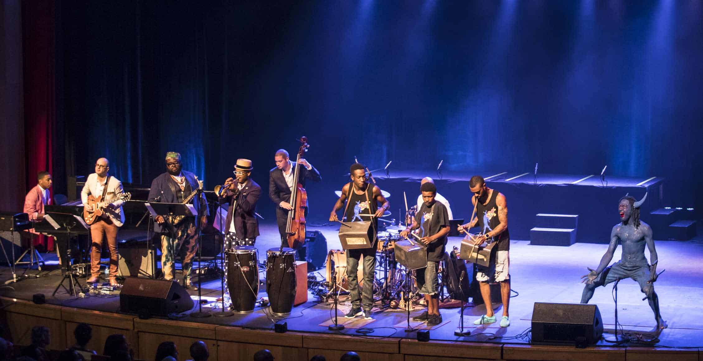 Blue Devil onstage with Etienne Charles and band. Photo: Maria Nunes